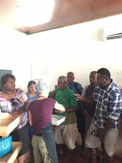Fijiana cacao farmers tasting chocolate